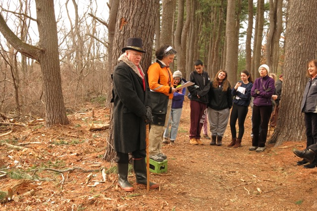 Anne-Marie Lambert (second from left) reads poetry at the Pine Allee, with John Perkins Cushing (as impersonated by Bob Tanner) and 25 local enthusiasts, participating in a February 21 nature poetry walk on Lone Tree Hill conservation land in Belmont. / Michelle Tanner