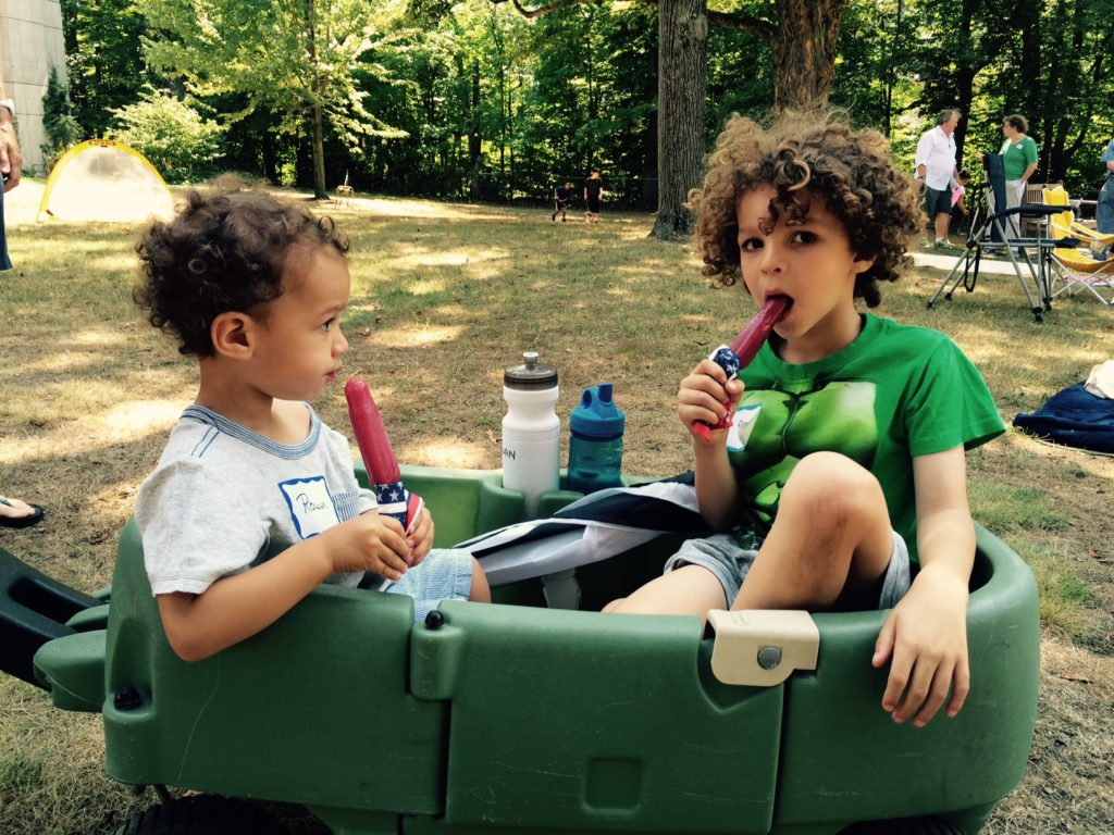 Popsicles in a boat. What better way to survive a hot summer day? Rowan Camara, 2, and Milo Camara, 5, of Woburn, enjoyed the Staycation Picnic at the Wellington Station park.